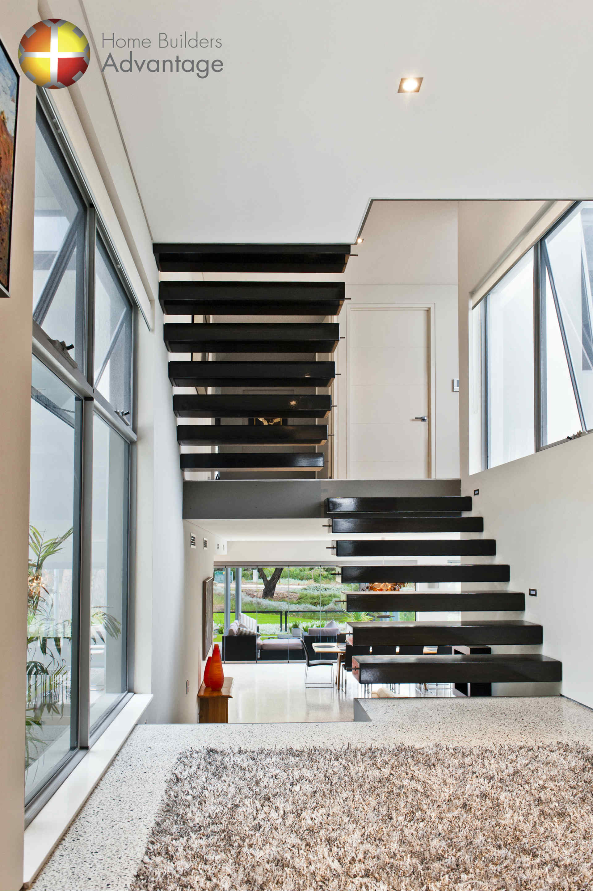 floating-staircase-in-triple-storey-home-designed-by-hba