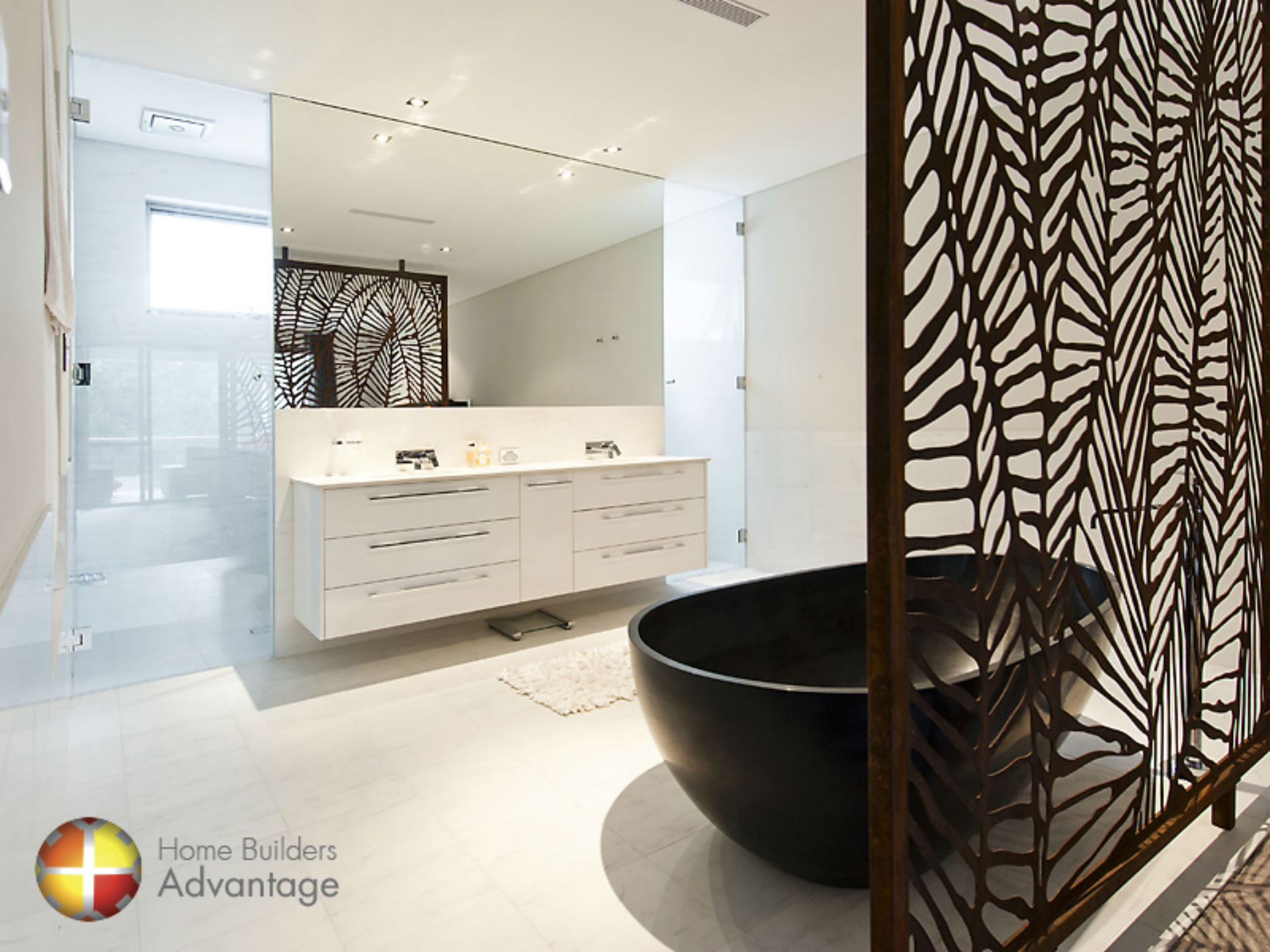 ornate-privacy-screen-between-master-and-ensuite-with-stone-oval-freestanding-stone-bathtub