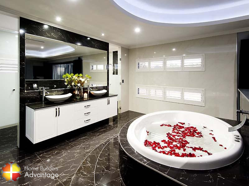 Hotel style Ensuite with oval spa bath and curved steps